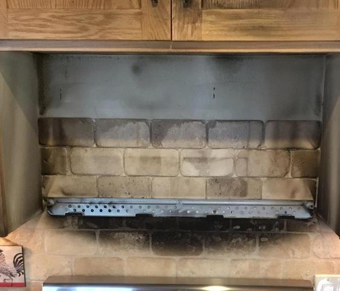 Kitchen Fire Burns Cabinets and Wall